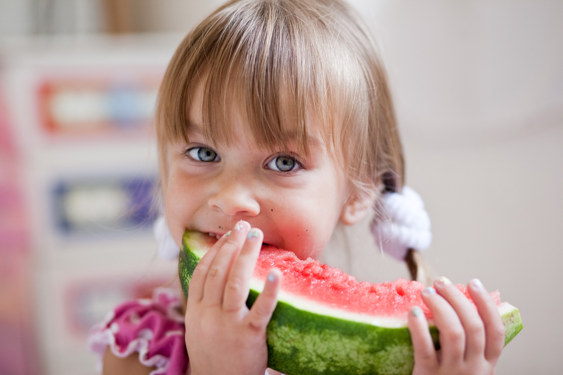 Fauuny child eating watermelon closeup