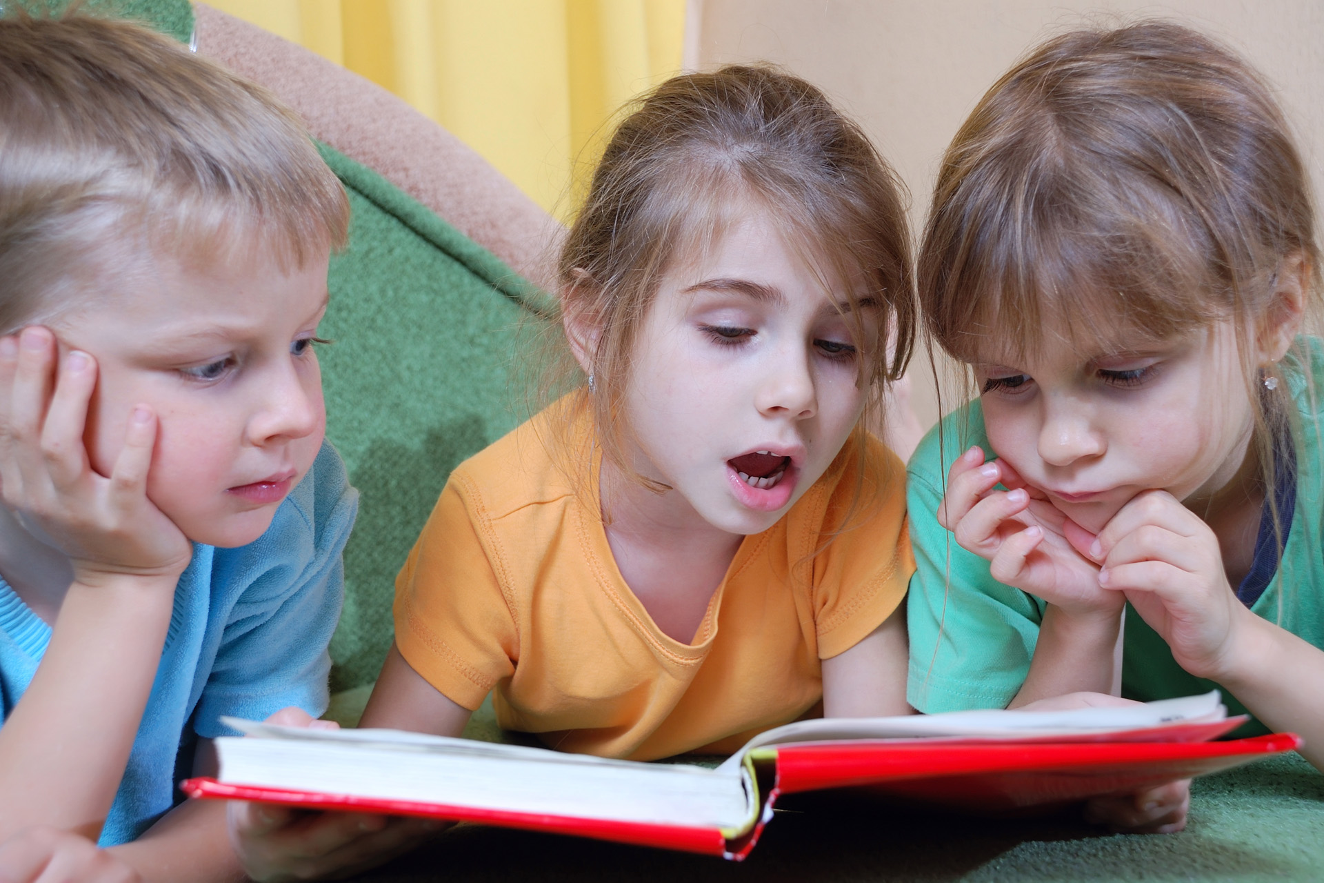 """group of 5 year old kids reading their first """"real thick"""" book themselves"""